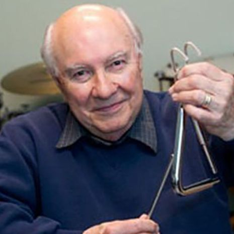 Alan Abel holding a triangle