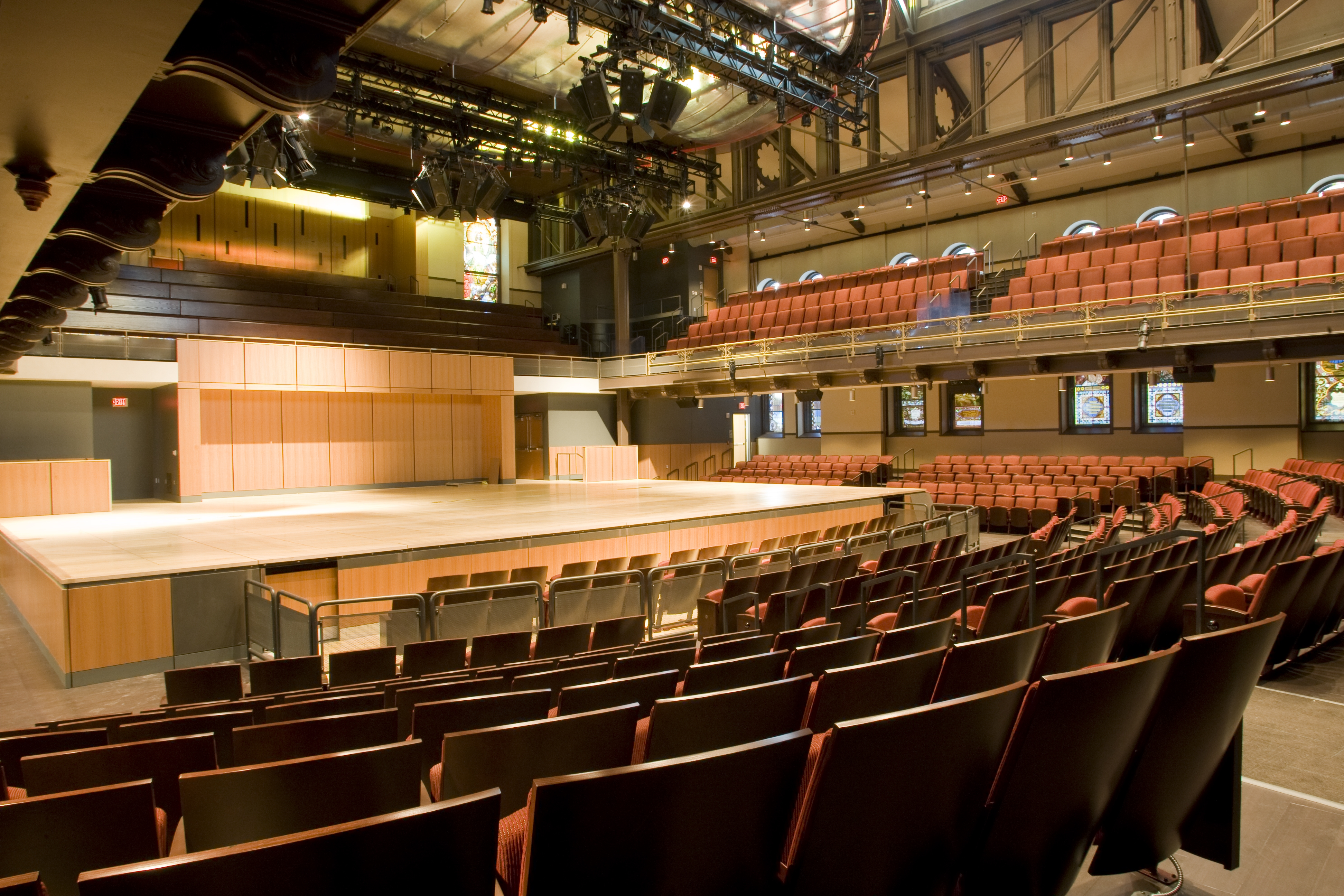Large performance hall interior, house lights up