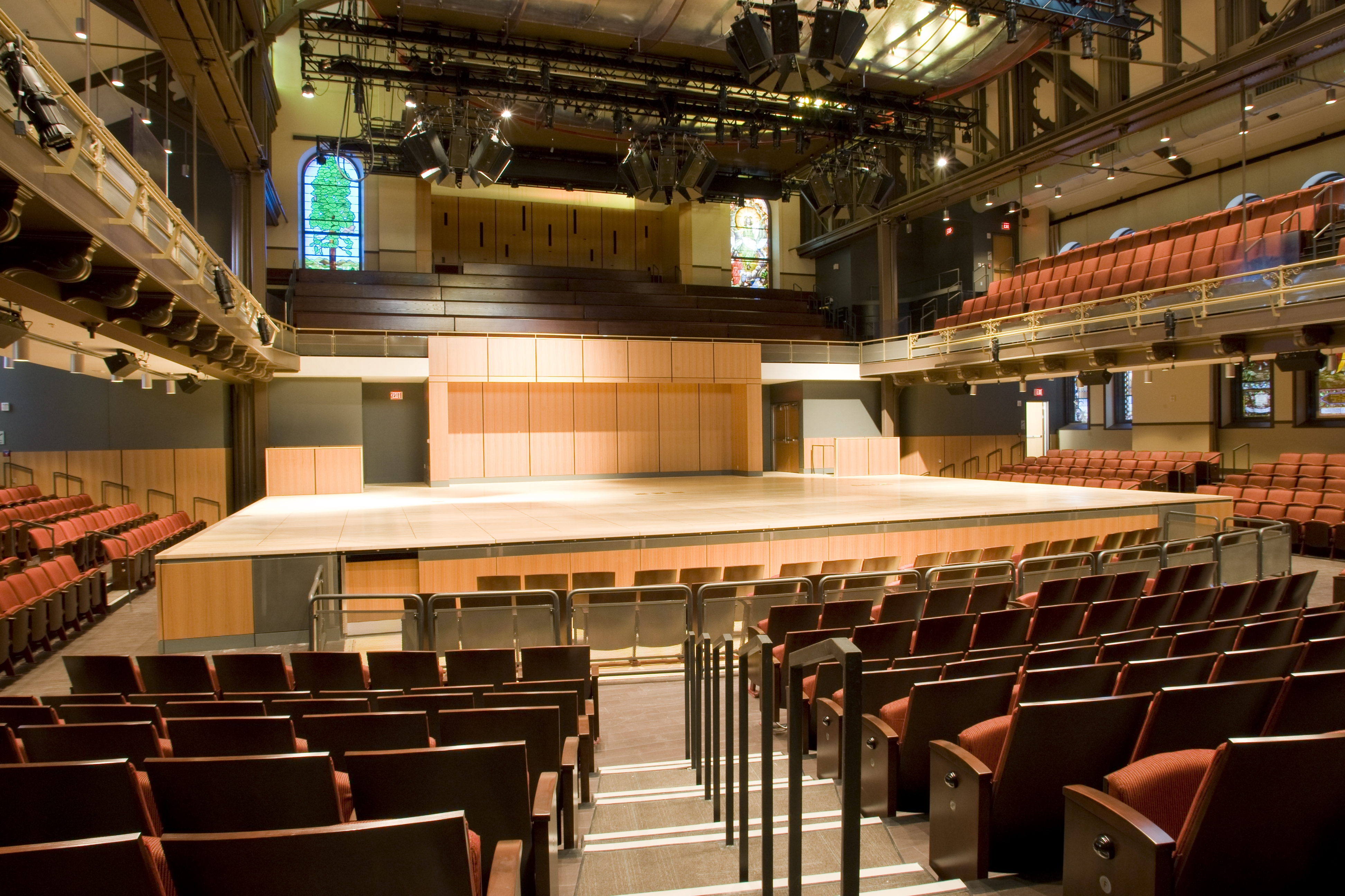 Large performance hall interior, house lights up