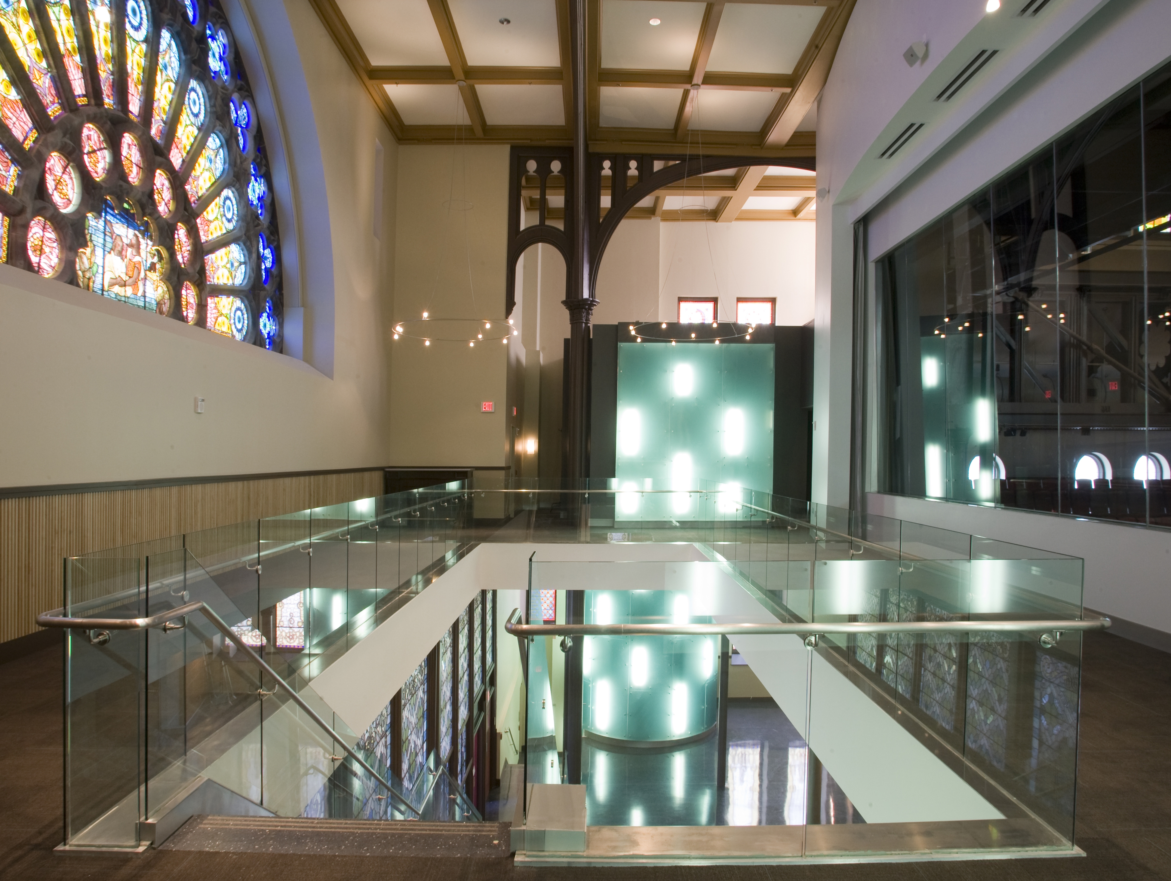 Performance hall second floor lobby with large stained glass window
