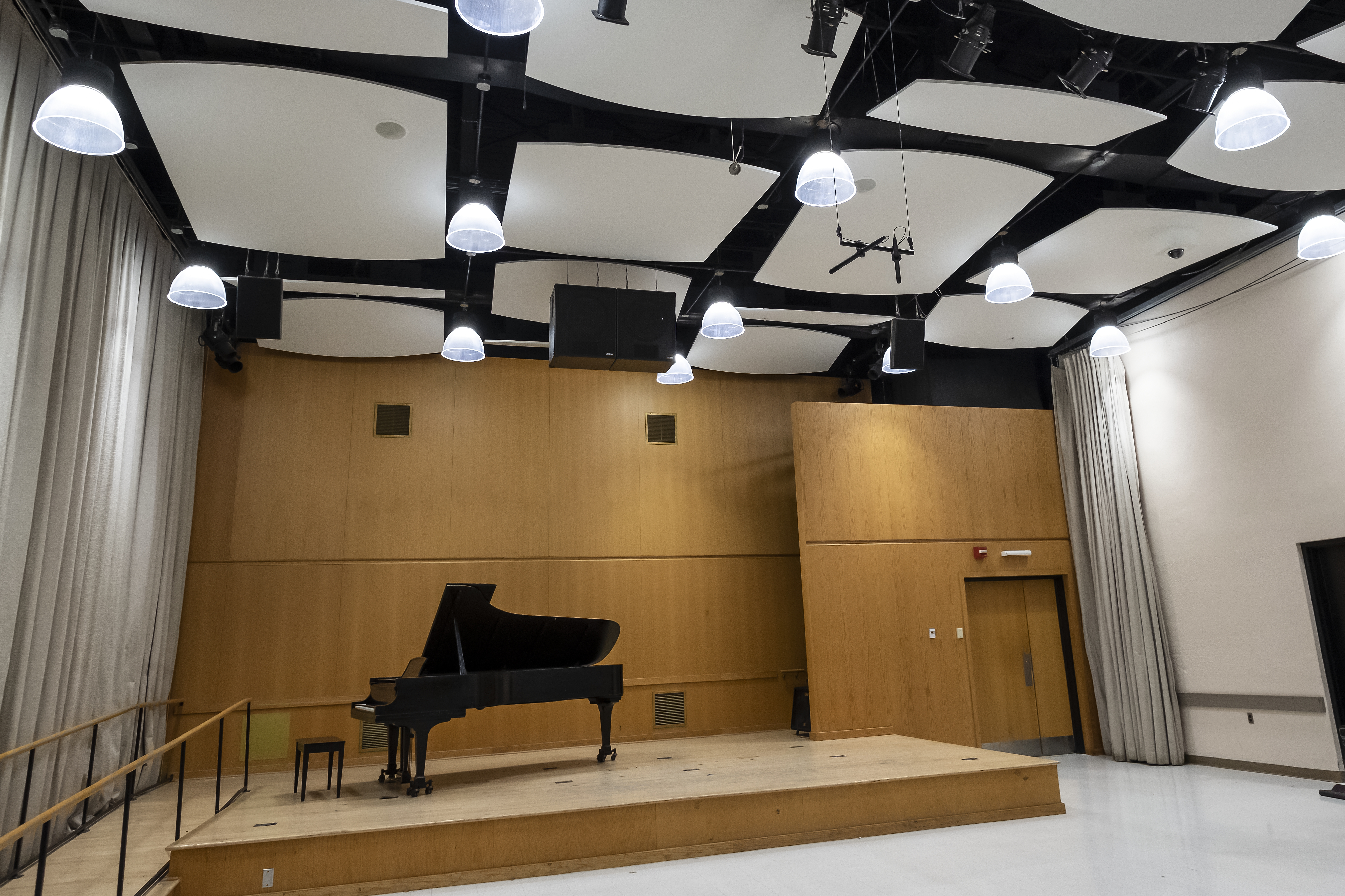 Wooden stage with grand piano on it