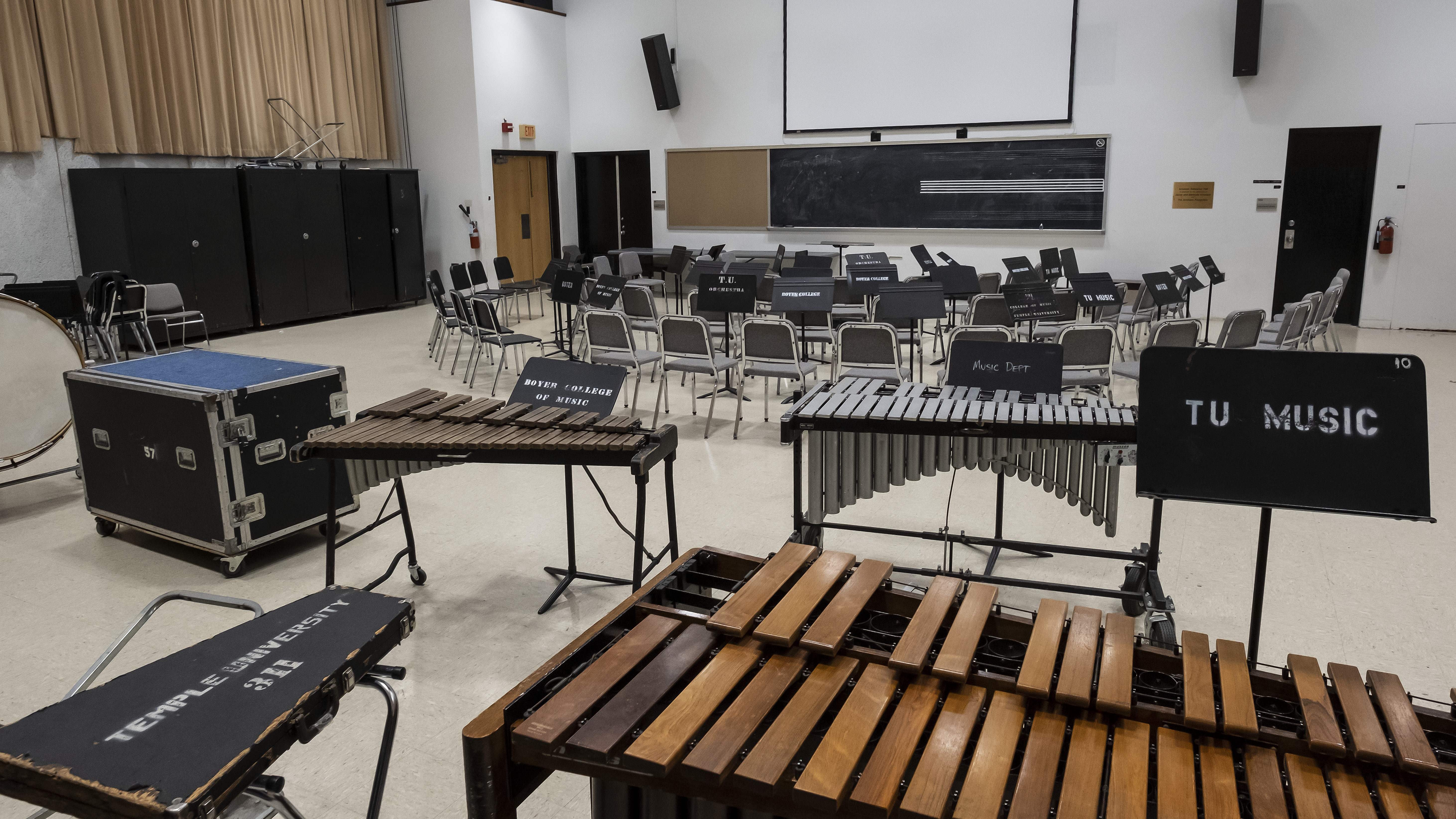 Rehearsal space with two marimbas and one xylophone, three rows of chairs in front of them