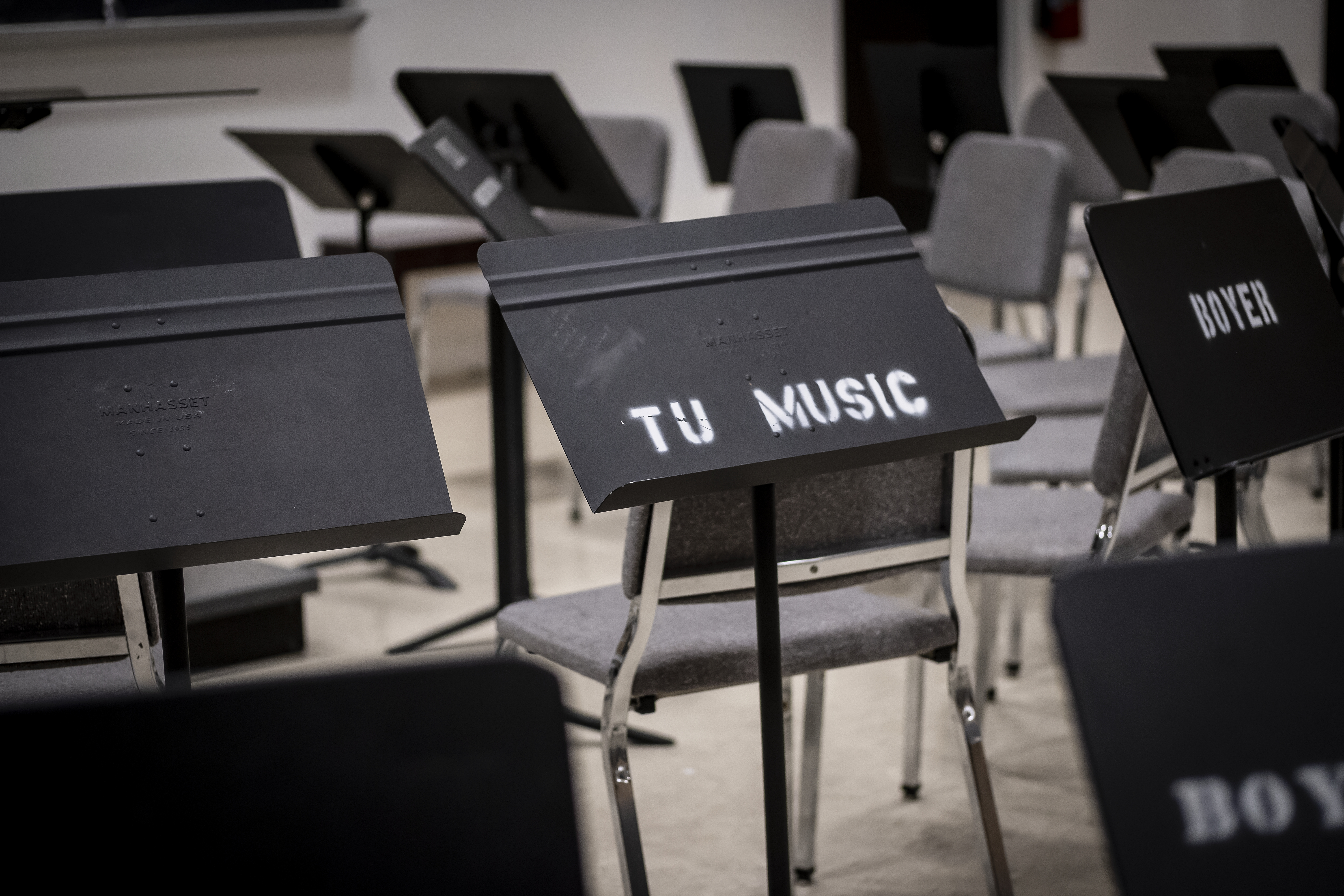 Close up of chairs and metal music stands
