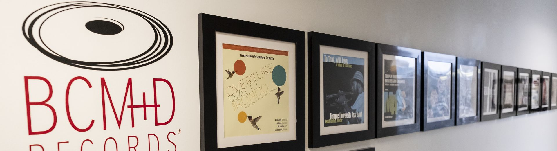 Wall with BCM&D logo and line of framed album covers