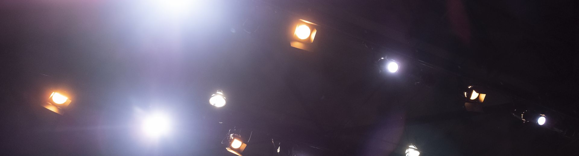 Orange and white spotlights above stage