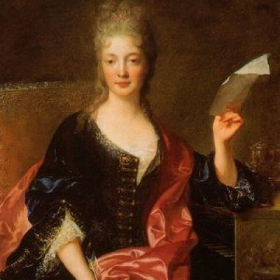 renaissance painting of a woman in a dark blue dress and pink shawl, holding a piece of paper